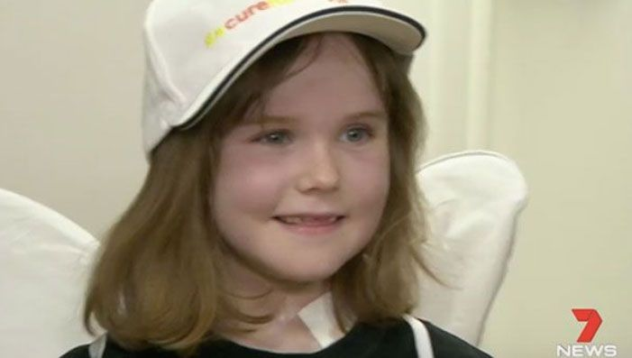 News story screenshot of young girl after receiving surgery