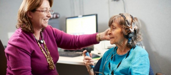 ENT Specialist conducting a hearing test on an elderly patient