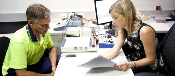 ENT specialist explaining test results to a patient